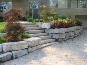 Retaining stone wall and interlock driveway by All Pro Landscaping